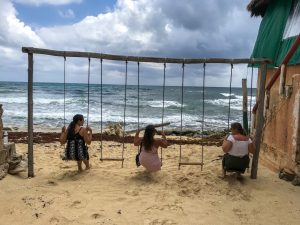 Swinging on swings on beach