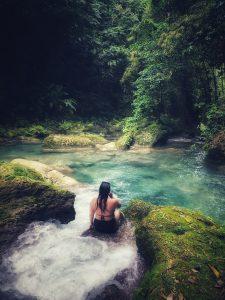 Sitting at Reach Falls looking at scenery