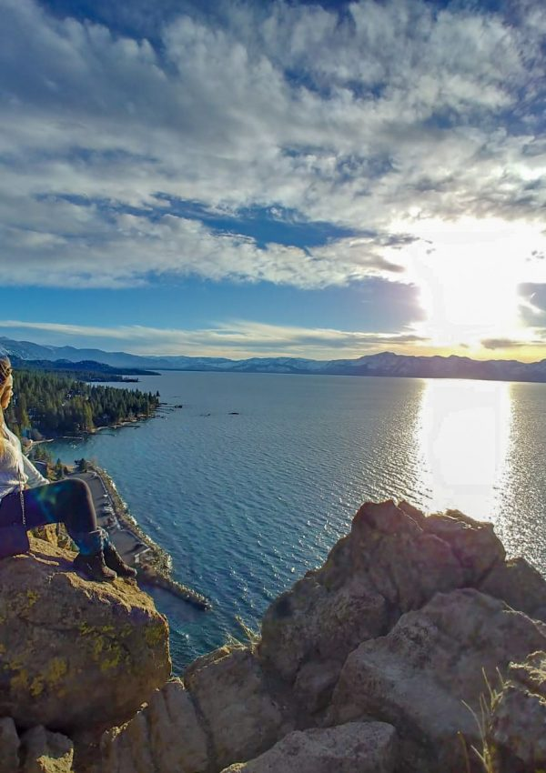 Me sitting on a rock looking at South Lake Tahoe