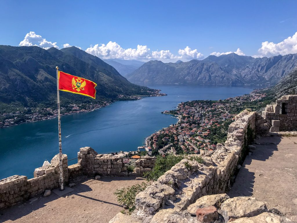 View of Kotor with Montenegro flag
